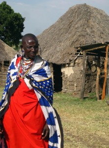 Masai-woman-and-her-hut-222x300